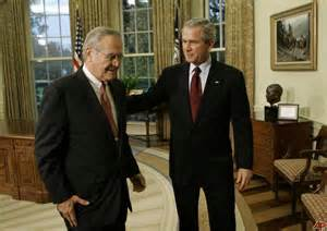 Donald Rumsfeld and G. W. Bush