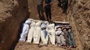 Shaam News Network (8/22/2013) showing bodies being buried in Damascus after killed by rebel forces.