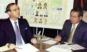 Vladamiro Montesinos and Alberto Fujimori before being charged with money laundry of $23 million USA dollars