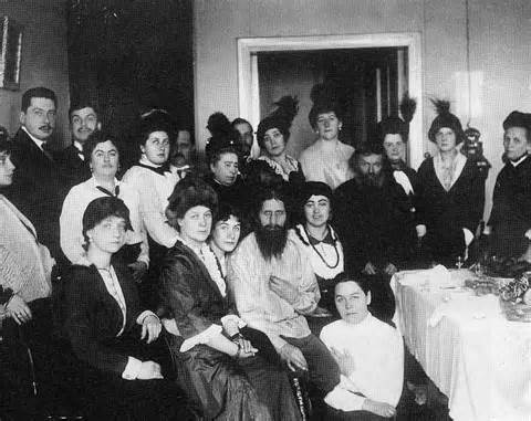 <i>Grigori Rasputin controlled the Romanov family and many aristocrats.</i> Center first row.