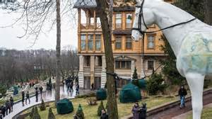 <i>Unaware of the wealth stolen from Ukrainian people, Ukrainians wander around Yanukovych's multi-million dollar palace and its private grounds and zoo.</i>